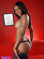 Getting naked on the couch. Exotical ebony tranny stripping on